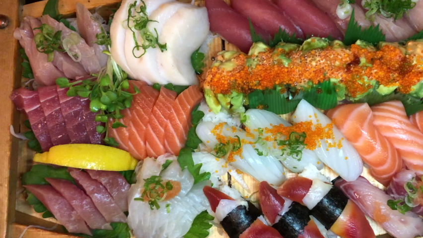 4K HD video panning across large tray of sushi and sashimi.   | Shutterstock HD Video #1081013666