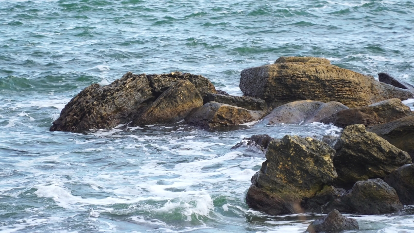 Stormy sea with large stones | Shutterstock HD Video #1081040768