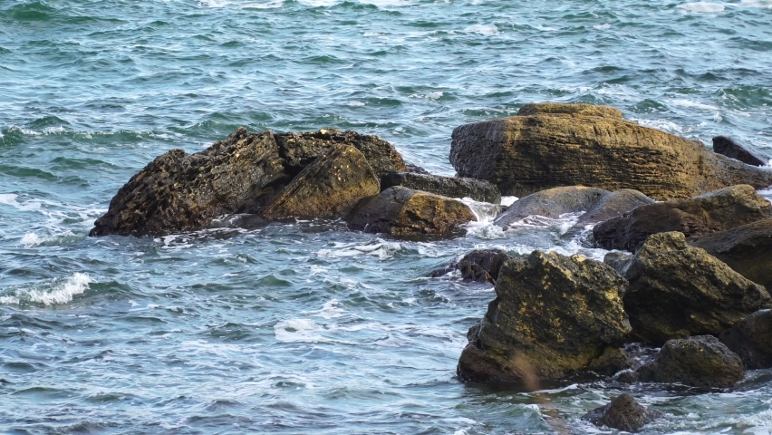Stormy sea with large stones.hands shooting | Shutterstock HD Video #1081043351