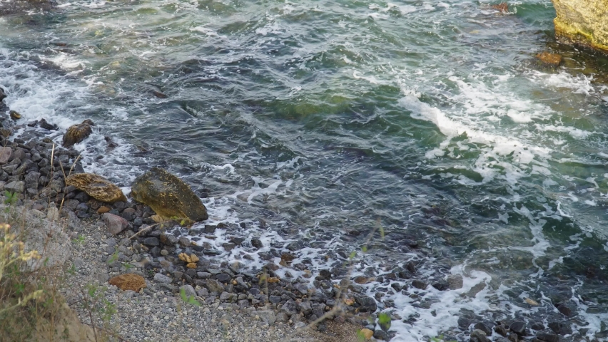 Stormy sea with large stones.cave beach | Shutterstock HD Video #1081043354