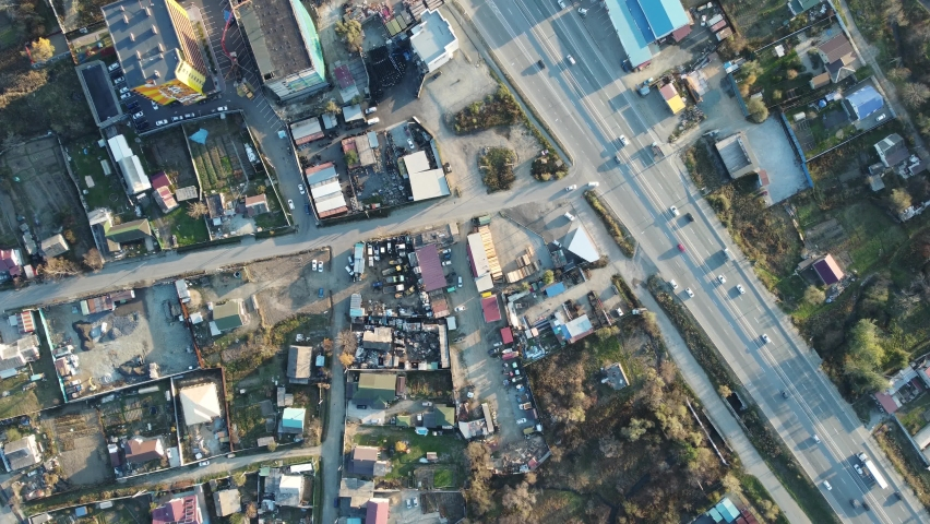 Aerial view, two-lane highway with cars moving along it during the day | Shutterstock HD Video #1081065350
