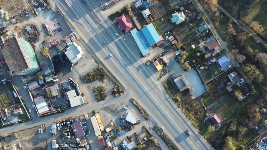 Aerial view, two-lane highway with cars moving along it during the day | Shutterstock HD Video #1081066295