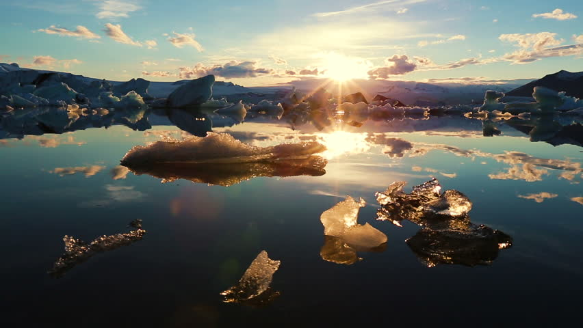 Icebergs Lighting up like Crystals During Sunrise in Glacier Lagoon. Aerial Shot. Iceland.