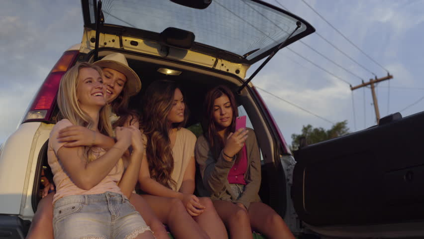 Group Of Teen Girls Watch Sunset From The Back Of An SUV, They Take Selfies Together (4K) #10811882