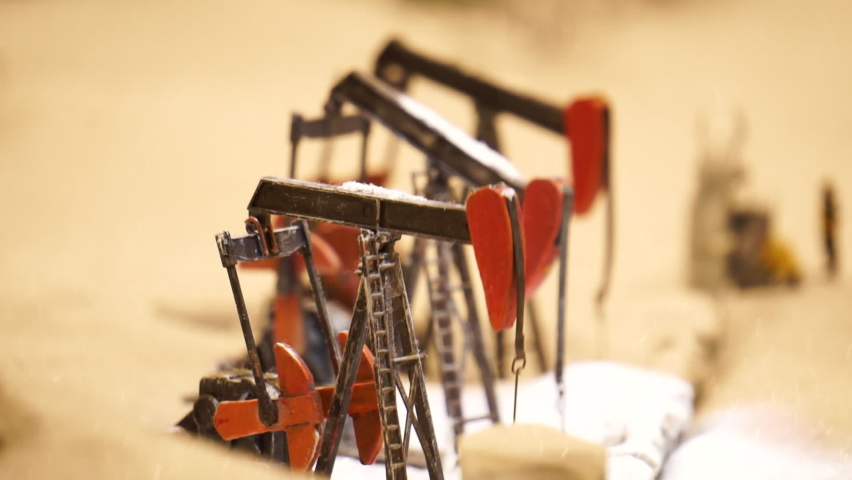 Oil rocking chair units in conceptual representation. Footage. Stopping the oil pump, preserving the environment. Representing the Oil Industry with a Scale Model | Shutterstock HD Video #1081193990