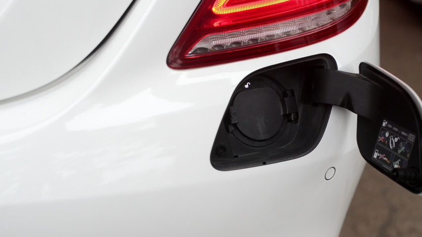 The position of the charger plug of electric cars or EV which in driving will not dust emissions into the atmosphere of the world. | Shutterstock HD Video #1081200443