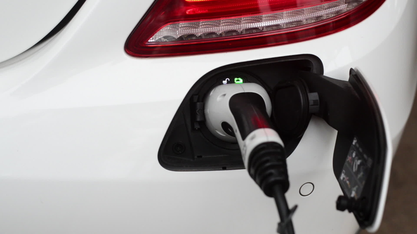 The position of the charger plug of electric cars or EV which in driving will not dust emissions into the atmosphere of the world. | Shutterstock HD Video #1081200446