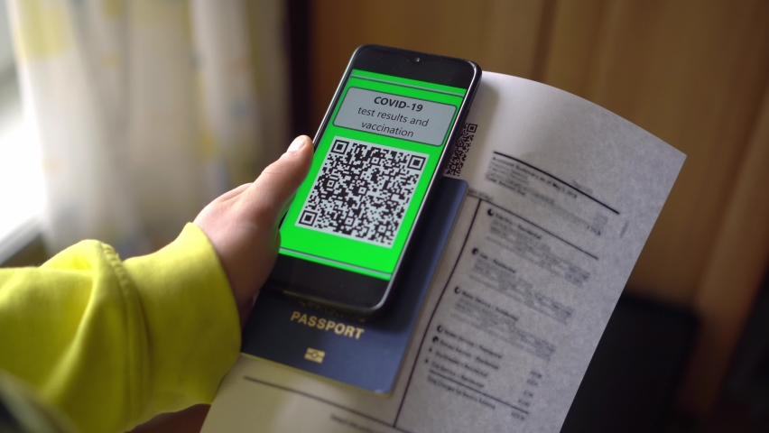QR code app during Coronavirus pandemic. COVID-19 Test Results on the smartphone screen. Data on movement, contacts with infected, crossing the state border, the presence of antibodies, vaccination | Shutterstock HD Video #1081274162