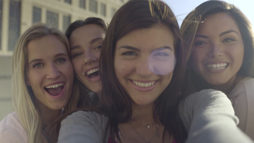 Closeup Of Carefree Teen Girls Making Funny Faces And Smiling For Selfies (4K) #10819841