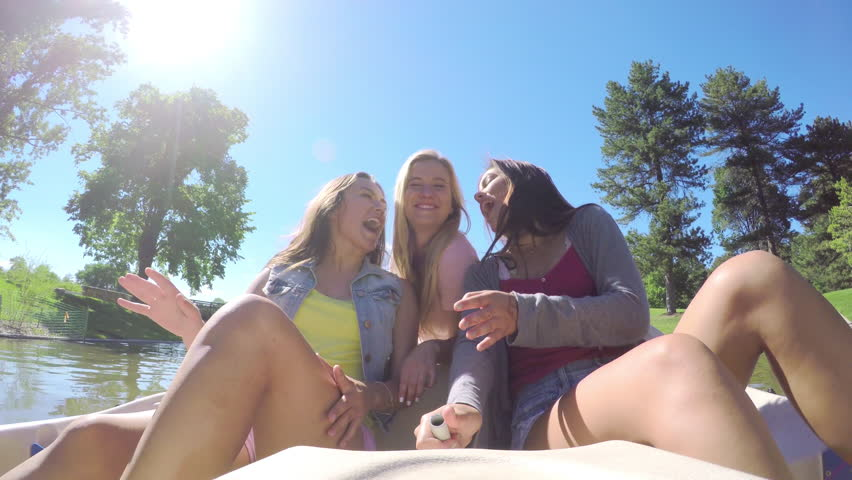 Fun Group Of Teen Girls Ride Around In A Pedal Boat, They Joke Around, Girls Kiss Their Friend On The Cheek At The Same Time (4K) | Shutterstock HD Video #10819856