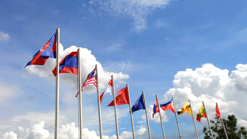 AEC or ASEAN flag waving atop among Southeast Asia nation flags on blue sky backgrund Royalty-Free Stock Footage #10824683