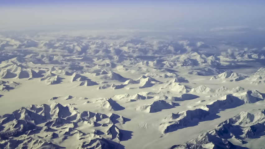 Aerial view of arctic mountains near Kluane National Park, Yukon Territory, Canada. Steady, slow motion shot.