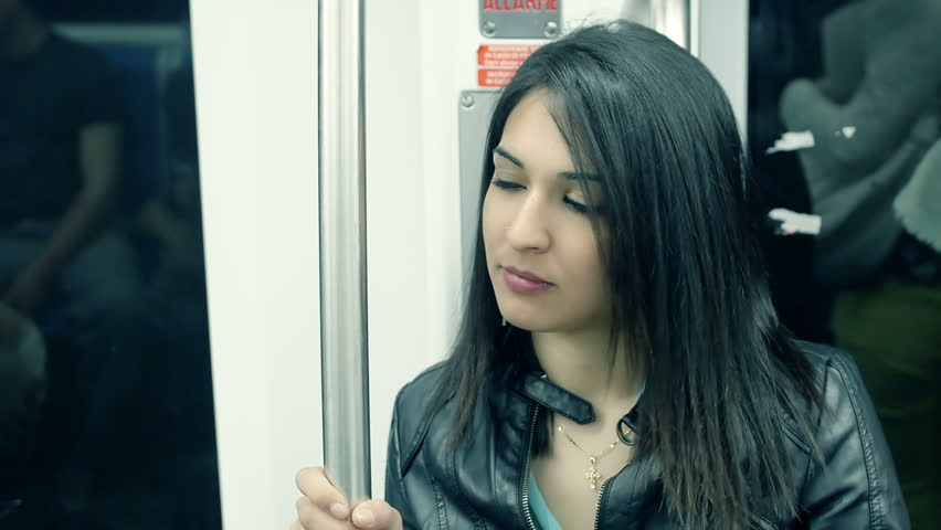 beautiful woman in the subway: having a journey on the subway train #10847960