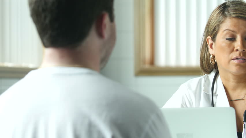 Female Doctor giving a patient prescription information, office setting | Shutterstock HD Video #10851749