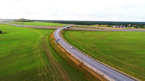 Camera follows blue bus, on the high-speed road. Aerial footage