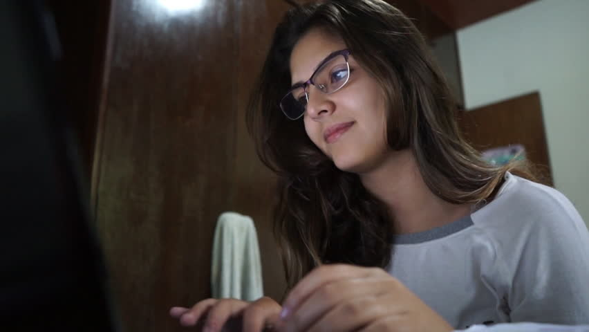 Young attractive Brazilian woman on her computer. Low angle 1080p HD. | Shutterstock HD Video #10854251