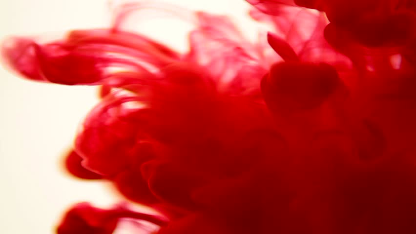 Colored Ink Dropped Into Water (red ink)