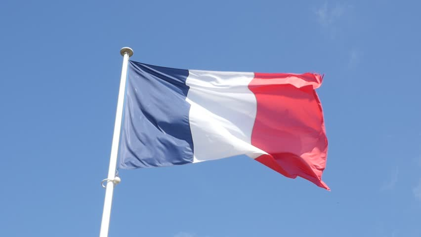 Slow motion of French flag fabric waving in front of blue sky 1920X1080 FullHD footage - Tricolor flag of France slow-mo flowing by the day 1080p HD video