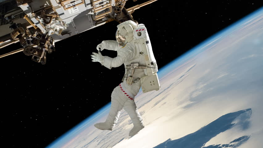 Astronaut Working On International Space Station. Elements of this image furnished by NASA #10886429