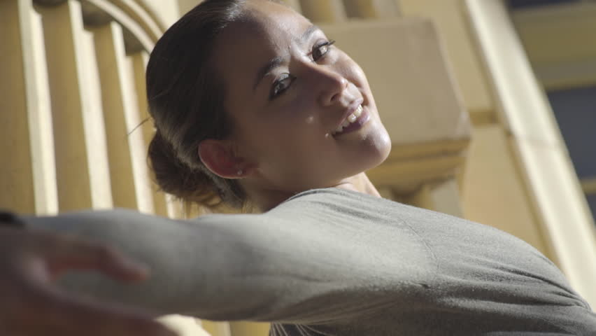 Beautiful Ballerina Practices Outside, Stretches Back, Toward Camera, Closeup Of Her Face (Slow Motion) #10902371