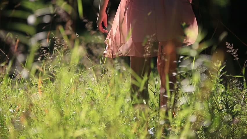 Girl Wearing Light Summer Dress Walking in the Field on Sunny Day Outdoors | Shutterstock HD Video #10958420
