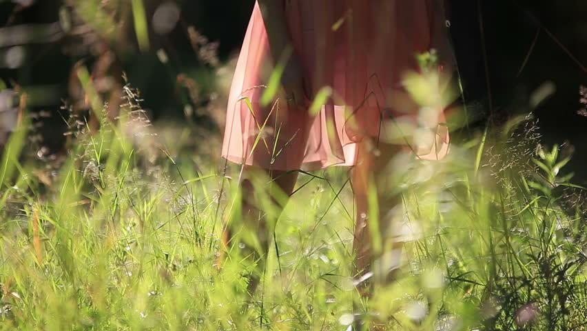 Girl Wearing Light Summer Dress Walking in the Field on Sunny Day Outdoors | Shutterstock HD Video #10958432