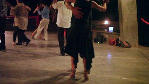 TAMIL NADU, INDIA - CIRCA SEPTEMBER 2012 - Couples dance tango, ballroom floor, shallow DOF