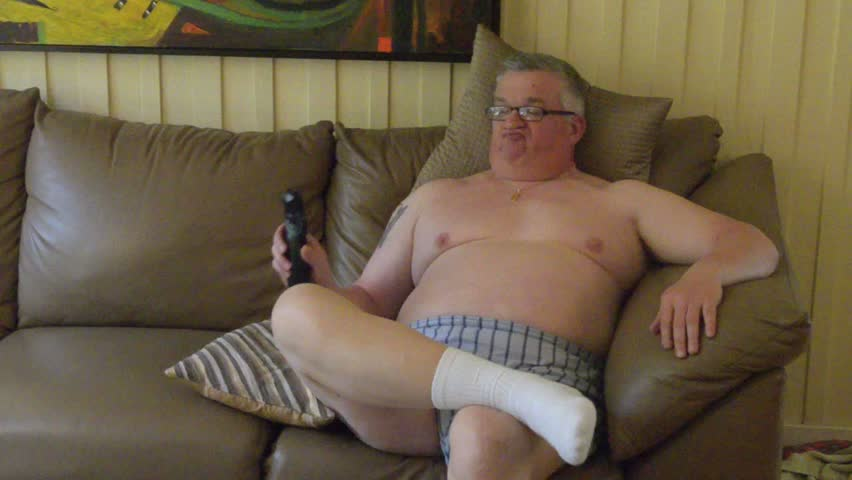 Fat man Sits in front of TV,couch potato