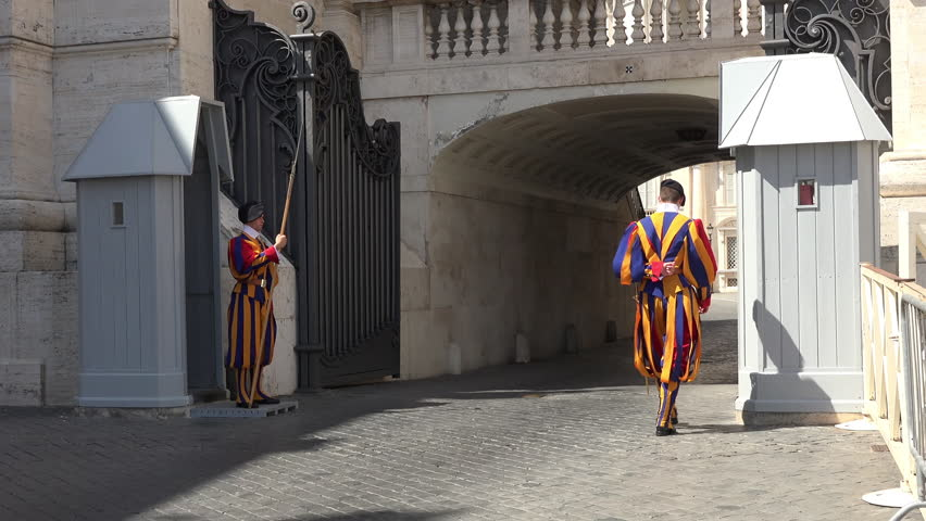 VATICAN CITY, ITALY - SEPT 2014: Rome Italy Vatican Swiss Guards by road entrance.  Papal Swiss Guard was founded in 1506. Modern military unit responsible for the safety of the Pope Apostolic Palace.