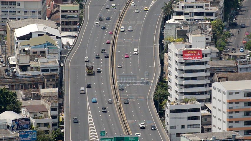 Overhead Time Lapse of Busy Elevated Freeway Traffic Daytime Bangkok Thailand - Circa May 2015 #11000174