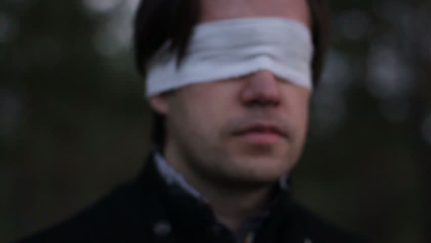 Blindfolded man in forest HD.Terrorism.