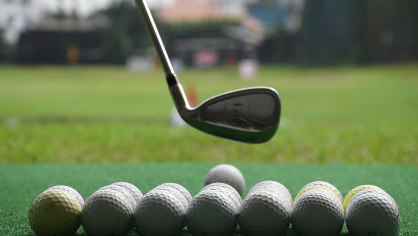 Golf ball behind driver at driving range | Shutterstock HD Video #11028959