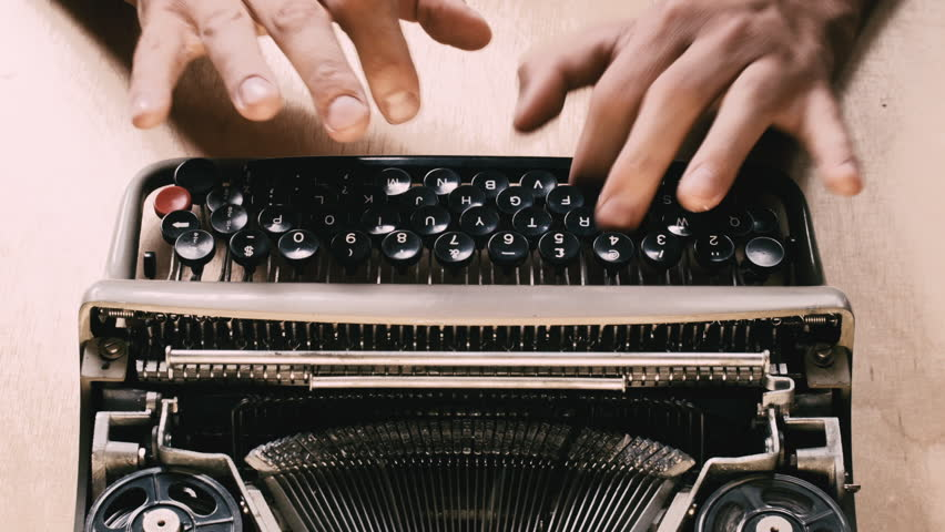 Typing a film script or a book on a vintage typewriter | Shutterstock HD Video #11032874