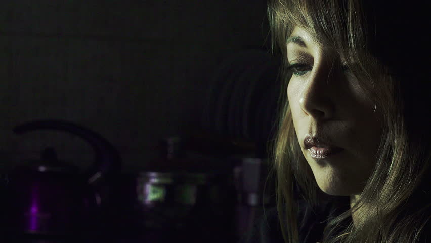 Young woman smokes in the night: woman smoking at home   | Shutterstock HD Video #11044148