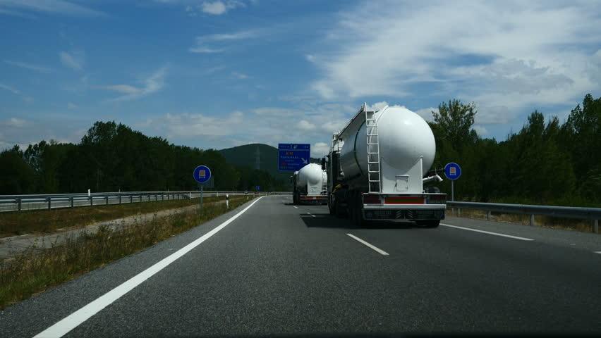 Subjective image driving, overtaking trucks of dangerous, A6 road to La Coruna, Spain, summer 2015. | Shutterstock HD Video #11052638