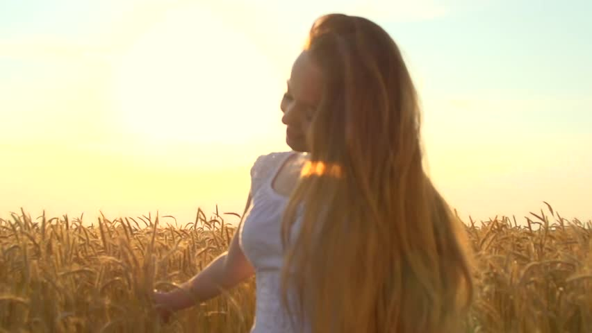 Beauty Girl with Healthy Long Hair Raising hands on wheat field. Outdoors. Happy Smiling Young Woman Enjoying Nature. Beautiful Lady having Fun in the field. Freedom. Sunset. Slow motion 1080    Shutterstock HD Video #11079272