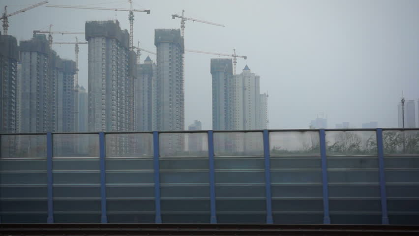 April.25,2015-Jinan,China: a construction sites seen from the window of a driving train #11108141