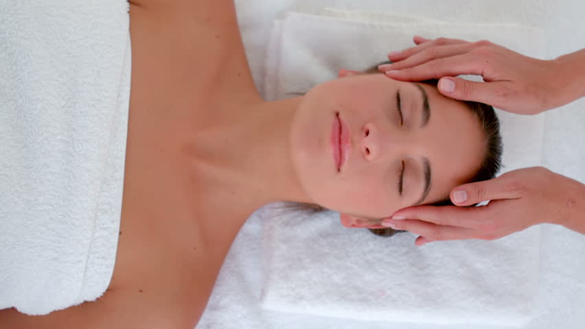 Attractive young woman receiving head massage at spa center in slow motion | Shutterstock HD Video #11119079