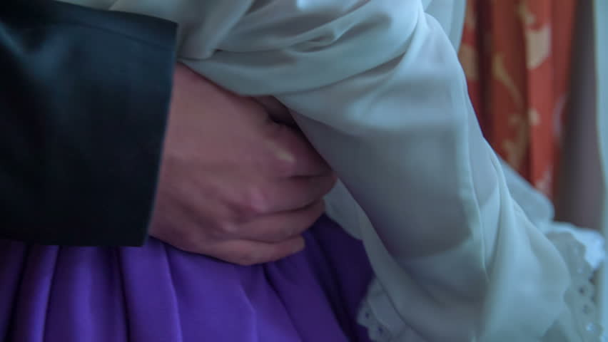 Man goes with a hand over the lady hips and and then goes away in the vintage room, historic close up footage.   Shutterstock HD Video #11153960