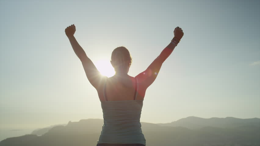 SLOW MOTION CLOSE UP: Young woman raising her hands on top of the mountain #11157920