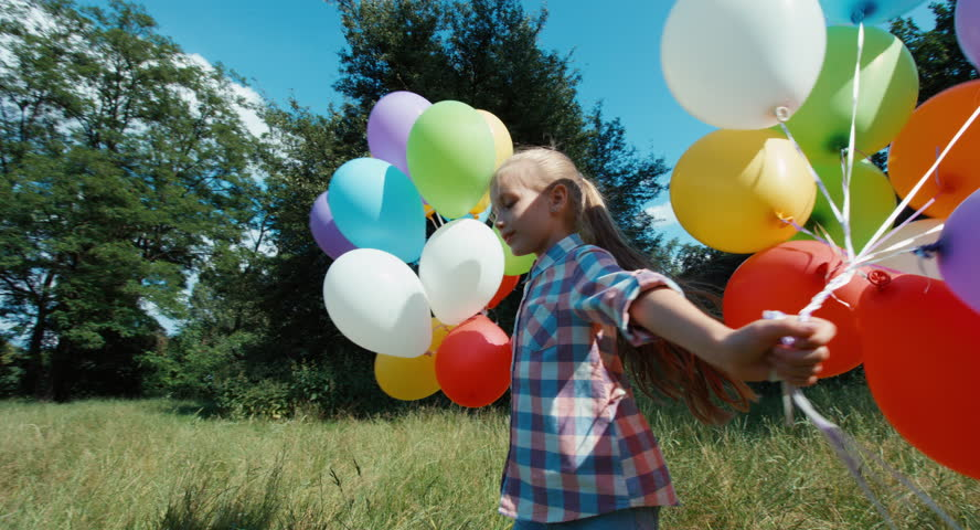 Portrait happy girl spinning with balloons | Shutterstock HD Video #11158367