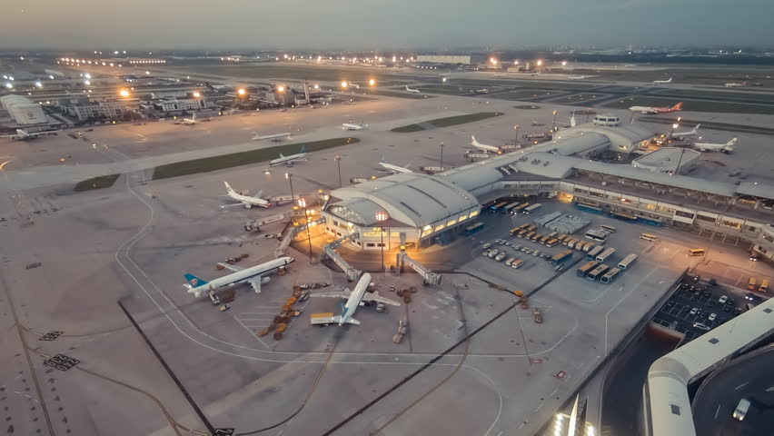 Timelapse.Aerial View.Airport Terminal at Sunset with Airplanes Taxiing and Landing. #11158940