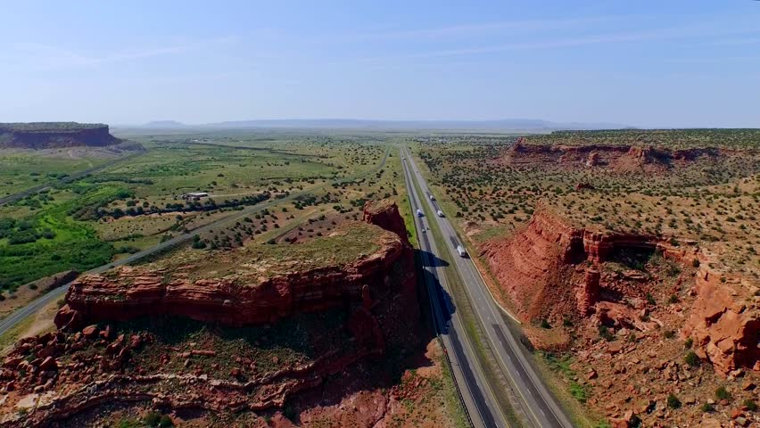 Highway in a beautiful canyon plain valley | Shutterstock HD Video #11159345