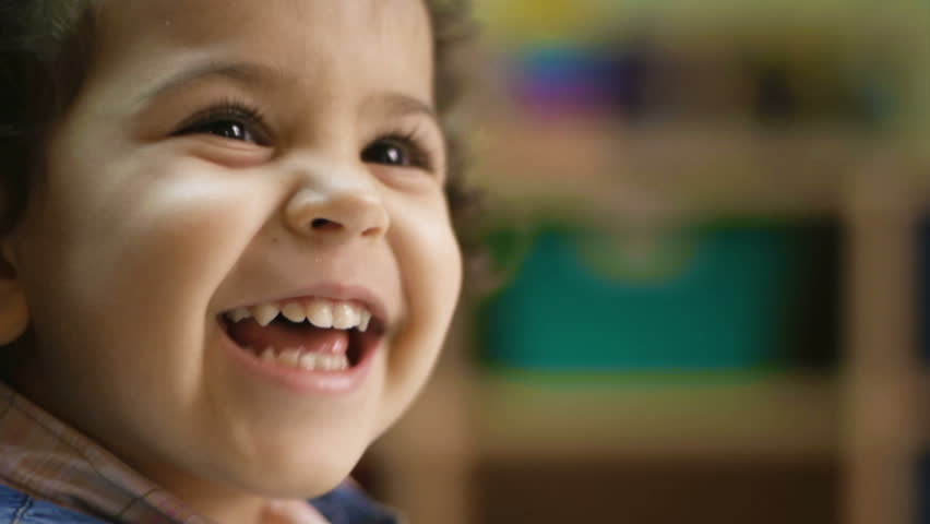 Baby girl laughing, clapping hands and having fun at kindergarten. Child, children, education, school