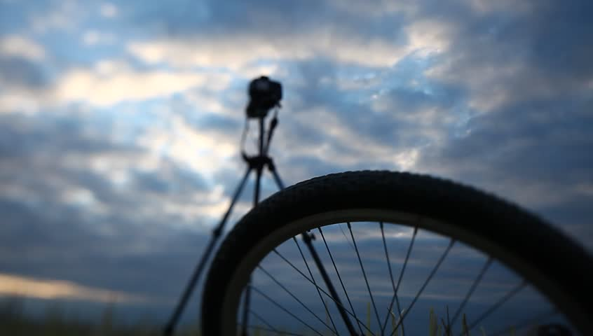 Camera on a tripod on the background of sunset cloudy sky | Shutterstock HD Video #11164043