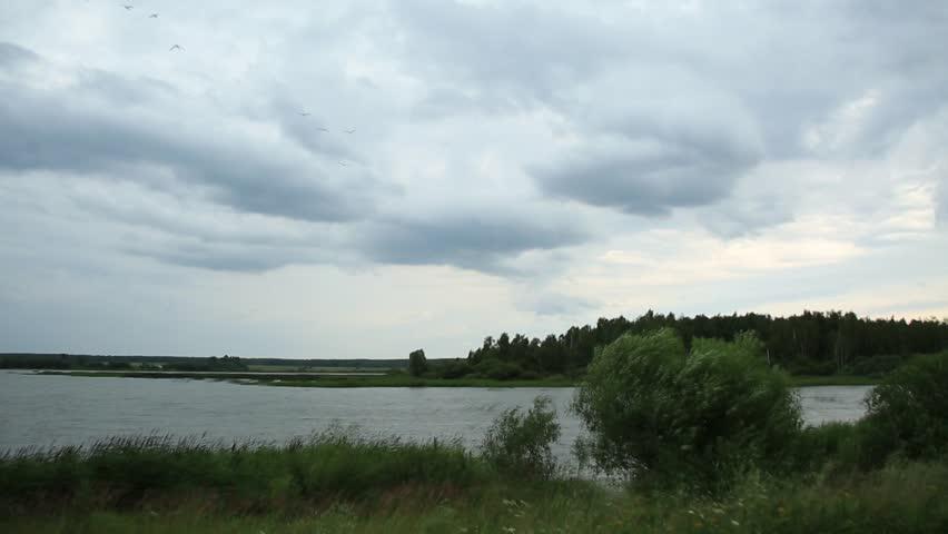 RUSSIA – JULY 25, 2015 : Lake landscape before the rain, accelerated video | Shutterstock HD Video #11166782