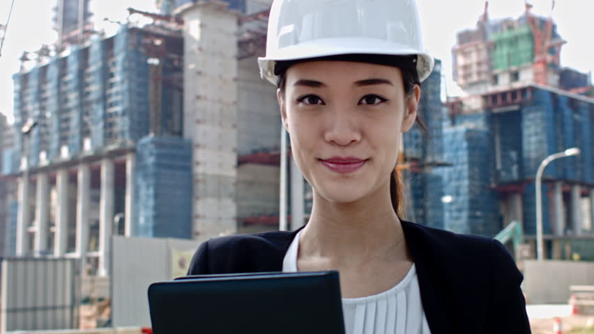 Engineer smiling with construction in Singapore asia chinese woman