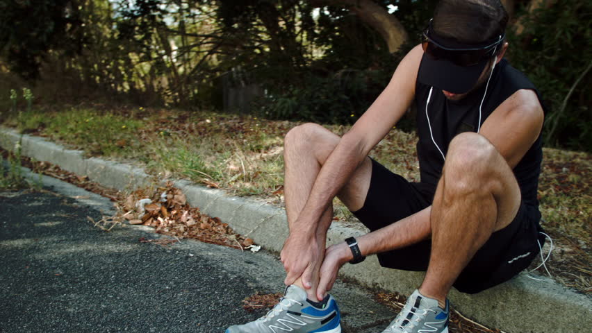 Marathon runner training injury ankle twist #11217626