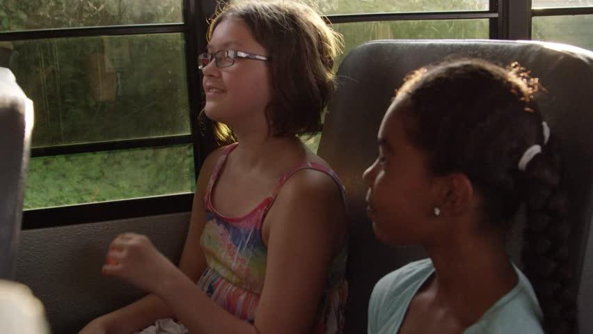 Young kids flirting on the school bus | Shutterstock HD Video #11235011