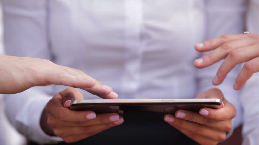 Close up of usage of a tablet by several people | Shutterstock HD Video #11237597